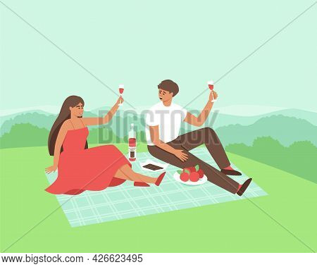 A Couple Is Drinking Wine In Nature. Happy Man And Woman Are Resting Together In Privacy. The Couple