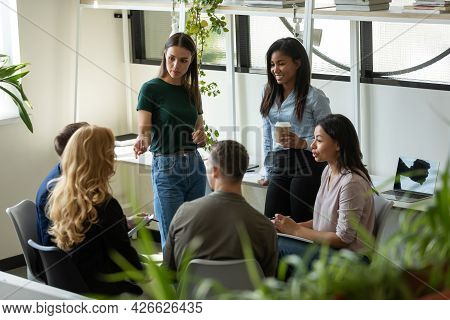 Millennial Business Team Meeting And Talking, Discussing Work Project