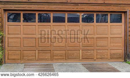 Pano Glass Paned Brown Front Door And Garage Door Of House In San Diego California