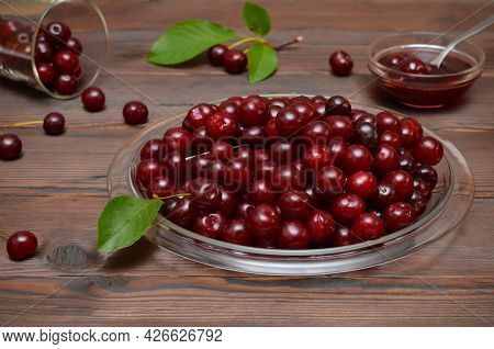Mouth-watering Ripe Cherries And Cherry Jam In A Bowl