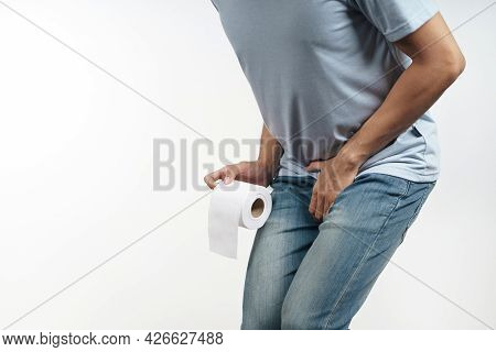 Young Man Holding His Crotch And Tissue Paper Suffering From Diarrhea, Incontinence, Prostatitis, Ve