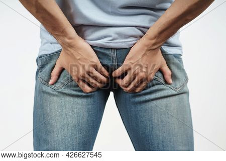 Young Man Holding His Bottom Because Diarrhea, Hemorrhoids, Constipation. Health Care And Medical Co
