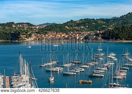 Port Of Lerici Town With Many Sailing Boats Moored And The Small Village Of San Terenzo, Tourist Res