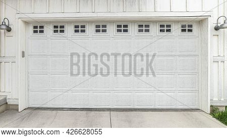 Pano White Panelled Wooden Door Of The Attached Garage Of Home With Small Glass Panes