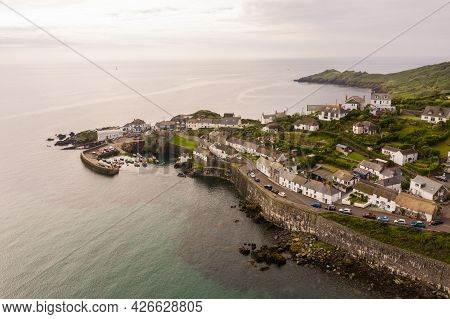 Coverack, Cornwall, Uk - June 29, 2021.  Aerial View Of The Picturesque Harbour And Fishing Village