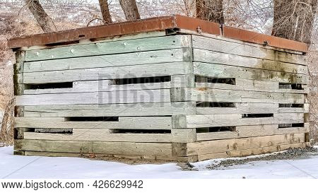 Pano Flat Roof Shed On Snow Covered Hill With Thriving Leafless Trees In Winter