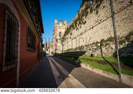 Medieval Surrounding Wall And Narrow Street Of The Small Village Of Lazise, Tourist Resort On The Co