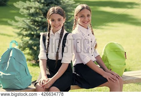 Exams. Happy Childrens Day. Childhood Hapiness. Two Sisters In School Uniform Outdoor. Ready For Hol