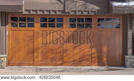 Pano Sunlit Exterior Of Home In Park City Uta With Glass Paned Brown Garage Door