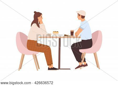 Young Love Couple Sitting At Table With Coffee In Cafe. Date Of Happy Enamored Man And Woman. Romant