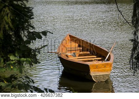 Big Boat On The Water. Lake, River And Old Wooden Rowing Fishing Boat. Boat For Excursion, Travel On