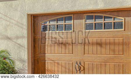 Pano Brown Glass Paned Wooden Garage Door Of Home In Huntington Beach California