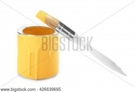 Can Of Yellow Paint With Brush On White Background