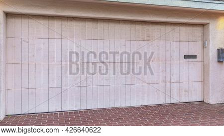 Pano Attached Garage Of San Dego California Home With White Door And Brick Driveway