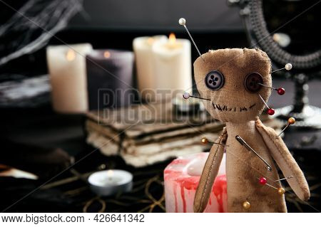 Voodoo Doll Pierced With Pins On Table Indoors, Closeup. Space For Text