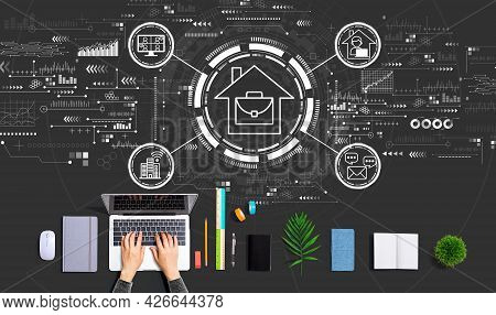 Telework Theme With Person Using A Laptop Computer