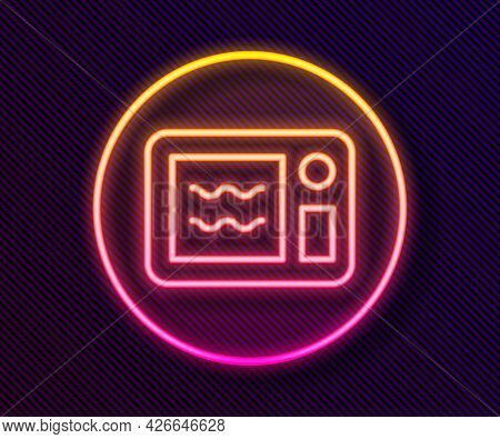 Glowing Neon Line Microwave Oven Icon Isolated On Black Background. Home Appliances Icon. Can Be Hea
