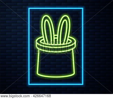 Glowing Neon Line Magician Hat And Rabbit Ears Icon Isolated On Brick Wall Background. Magic Trick.