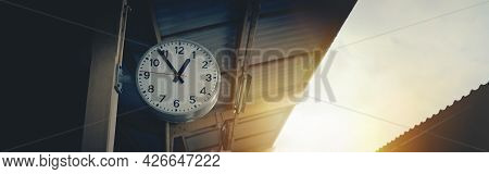 Retro Vintage Clock At Train Station And Banner Background Sunlight.