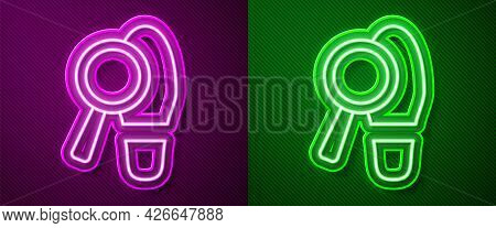 Glowing Neon Line Magnifying Glass With Footsteps Icon Isolated On Purple And Green Background. Dete