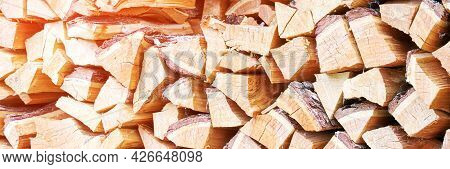 Wood Chop Stove. Woodpile Texture Background. Trees Store. Hardwood Pile Stack. Wooden Biomass Wall.