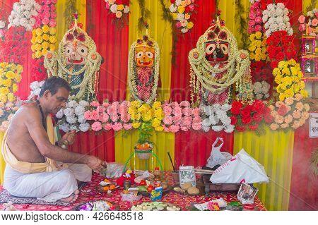 Howrah, West Bengal, India - 29th June 2020 : Hindu Priest Worshipping Idol Of God Jagannath, Balara