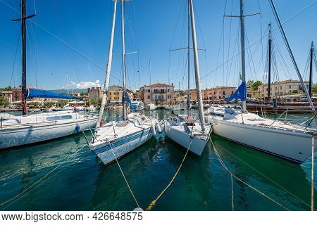 Port Of The Small Village Of Bardolino With Sailing Boats Moored, Tourist Resort On The Coast Of Lak