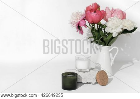 A Jug With Peony Flowers In Various Colors And Scented Soy Wax Candle. Fragrances For Home And House