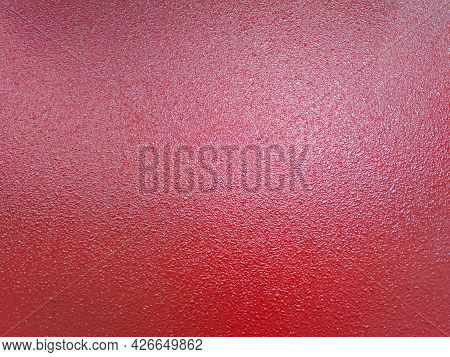Background Of Red Shagreen Powder Paint Coating On Flat Sheet Steel Surface