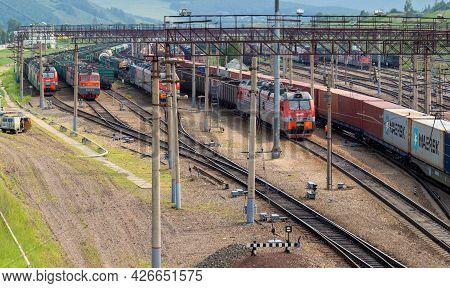 Krasnoyarsk, Russia - June 20, 2021: Cargo Trains On Complex Railway Station Of Trans-siberian Railw