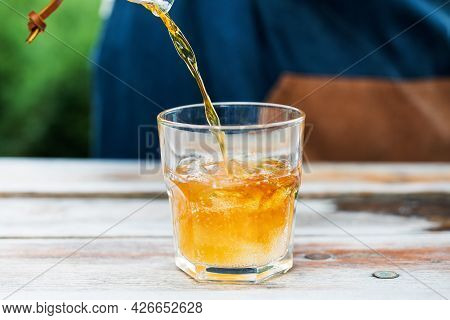 Cold Coffee Tonic. Coffee Is Poured Into A Glass With Tonic And Ice.