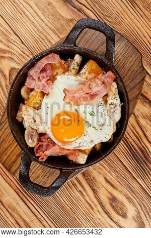 traditional breakfast with egg and sausage