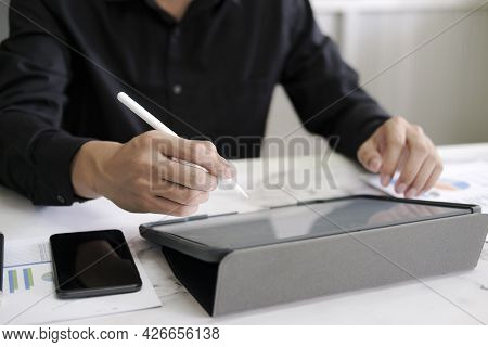 Business Man With Stylus Pen Writing On Digital Notepad
