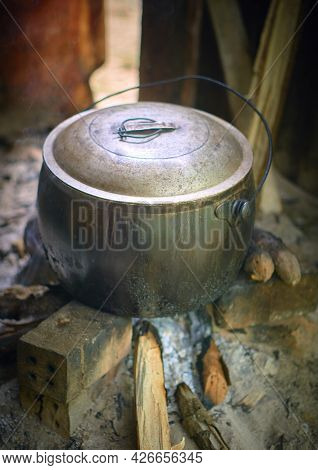 Close-up Of Cast Iron Pot For Cooking On Traditional Method.  Homemade Cooking. Dark. Still Life. Fo
