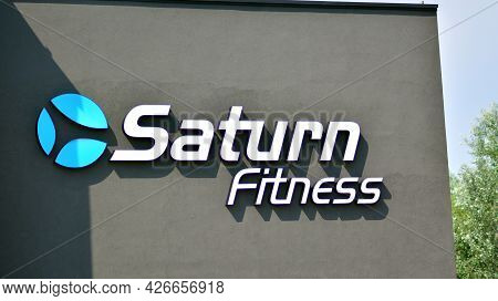 Warsaw, Poland. 13 July 2021. Sign Saturn Fitness. Company Signboard Saturn Fitness