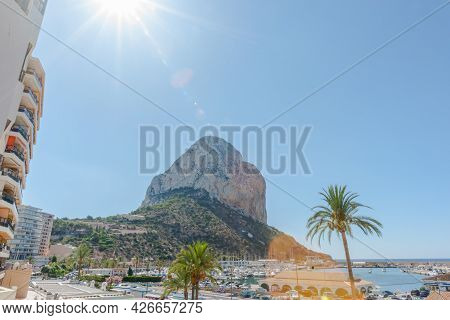 Sunshine And Lens Flare From Behind Rock Of Iflach A Landmark Large Rock At Calpe, Alicante Spain