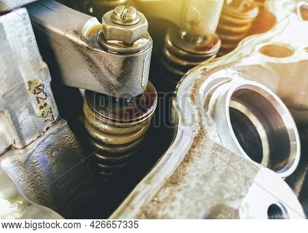 Spring Valve Of The Car Engine Valve Is Open For Adjustment Level In The Repair Garage