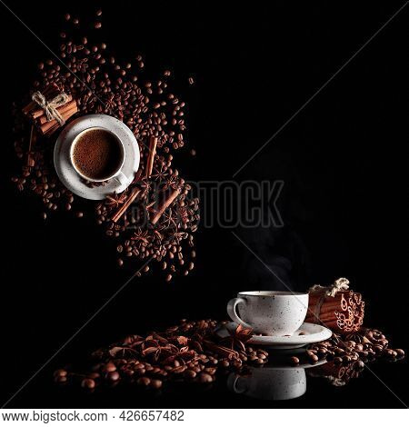 Black Coffee In A White Cup With Coffee Beans, Cinnamon Sticks, And Star Anise. Concept Image With A