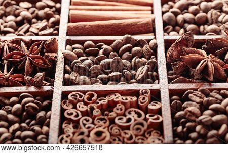 Roasted Coffee Beans, Cinnamon Sticks, And Anise, In An Old Wooden Box. Selective Focus.