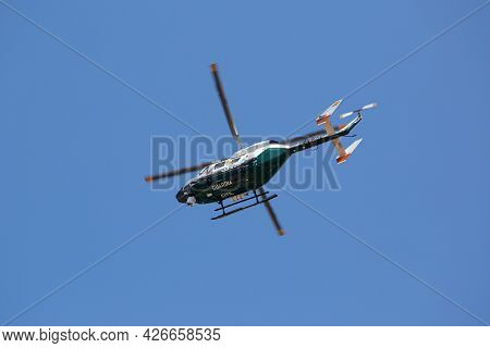 Galicia, Spain; July 8, 2021: Guardia Civil Traffic Surveillance Helicopter With Camera System Flyin