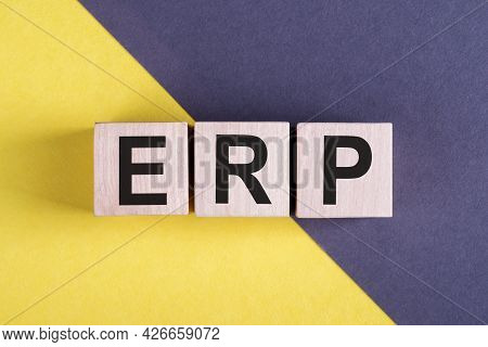 Word Erp - Enterprise Resource Planning, On Wooden Cubes On Yellow - Gray Background.
