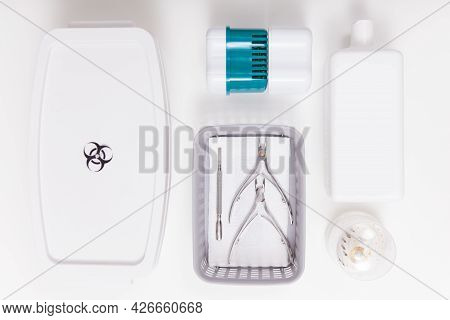 Top View Shot Of Sterilizing Box And Liwuid Disinfectant Bottle Near Manicure Instruments