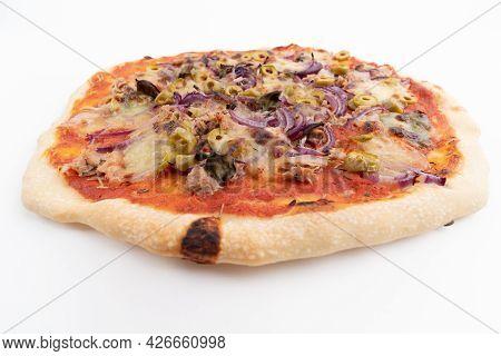 Wide Angle Studio Shot Of Freshly Baked Pizza Al Tonno Isolated On White Background. Tuna, Olives, O
