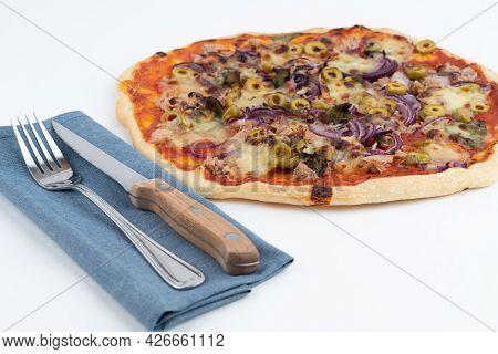 High Angle Studio Shot Of Freshly Baked Pizza Al Tonno Isolated On White Background. Tuna, Olives, O