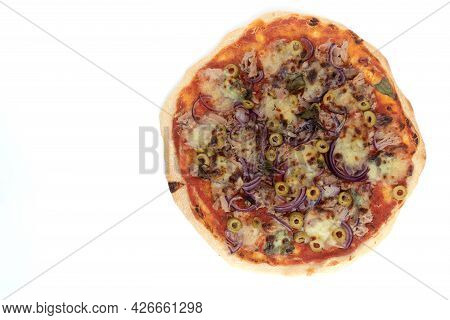 Top View Studio Shot Of Freshly Baked Pizza Al Tonno Isolated On White Background. Tuna, Olives, Oni