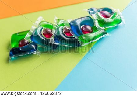 Washing Pods On Bright Background, Close Up, Abstract Color Background.liquid Detergent, Capsules Wi