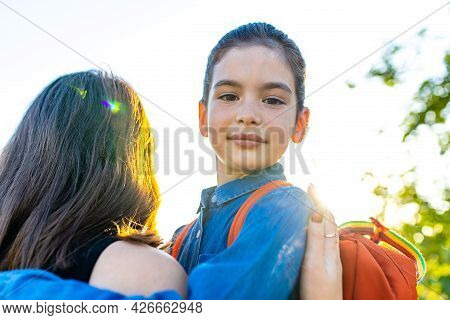 Smiling Indian Student Girl Wearing School Backpack And Blue T-shirt In Park