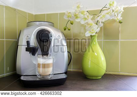 Coffee Machine Maker With A Latte Macchiato In Cozy Decorative Home With Green Wall And Flowers. Hom