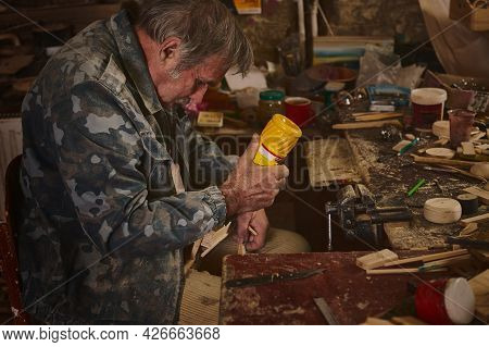 Craftsman Glues Wood Pieces Into A Model To Make Wooden Items In The Workshop. Arts, Skills And Hobb