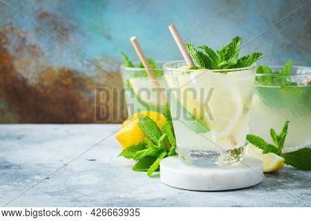 Two Glass With Lemonade Or Mojito Cocktail With Lemon And Mint, Cold Refreshing Drink Or Beverage Wi